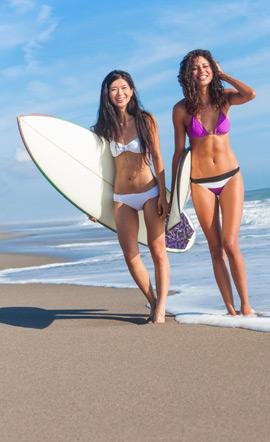 Summer on the beach - surfing bikini