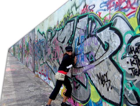 Lorraine Zander breaking down the Berlin Wall