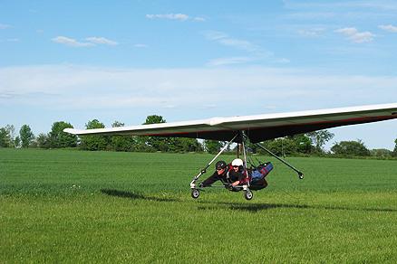 Hang Gliding. Dana finally comes back to Earth