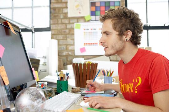 male intern at desk Internships Internship