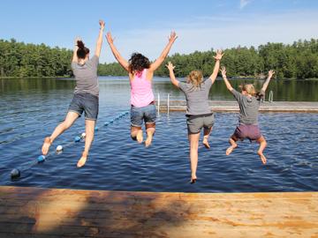 friends celebrate dock lake