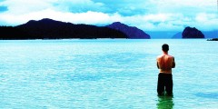 travel writer on beach