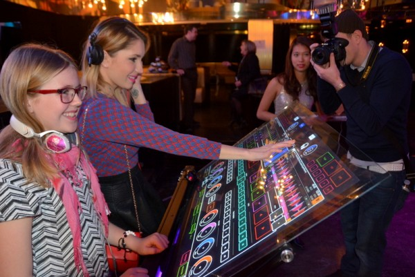 Canadian artist Anastasia A checks out the  Emulator Elite at the #YOUeffect Media Launch Party in Toronto.