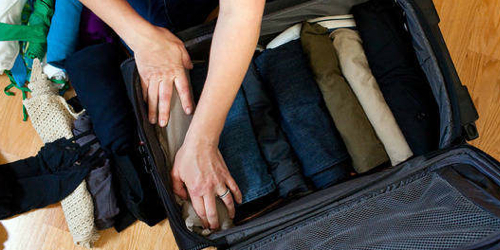 Packing clothes in a suitcase