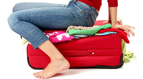Stuffed Suitcase - Essential Travel Items