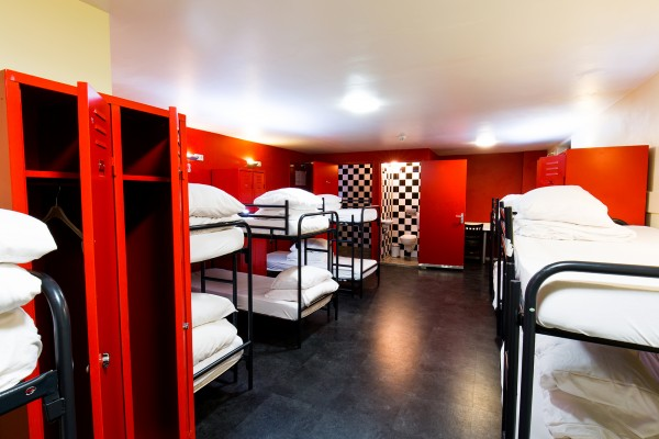 Black and white checkerboard and red coloured dorm room.