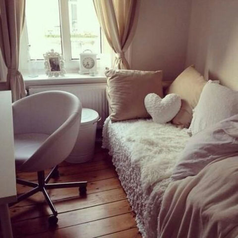 Dorm room with brown and white colour scheme.