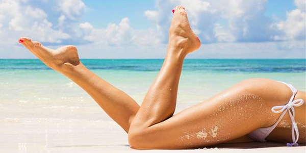shaving legs bikini beach