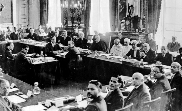 Mahatma Gandi attends an Indian Round table conference held at St,James palace, London, 14th September 1931, Photo shows: (right to left starting with white robed figure from right) The Paudit Malaviya, Mahatma Gandi, Lord Sankey, Lord Reading, Lord Peel and Sir Samuel Hoare (Photo by Popperfoto/Getty Images)