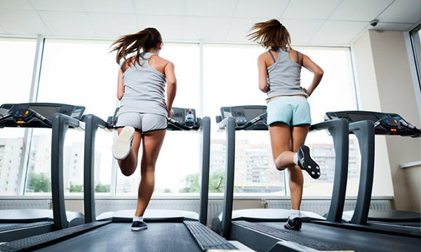 Girls Running on Treadmill at Gym